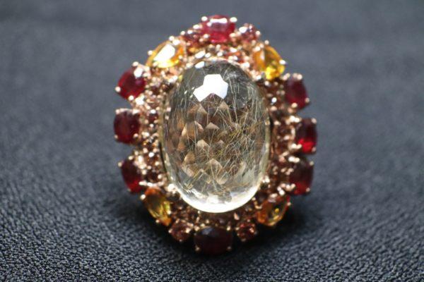 แหวนไหมทองล้อมด้วยทับทิม